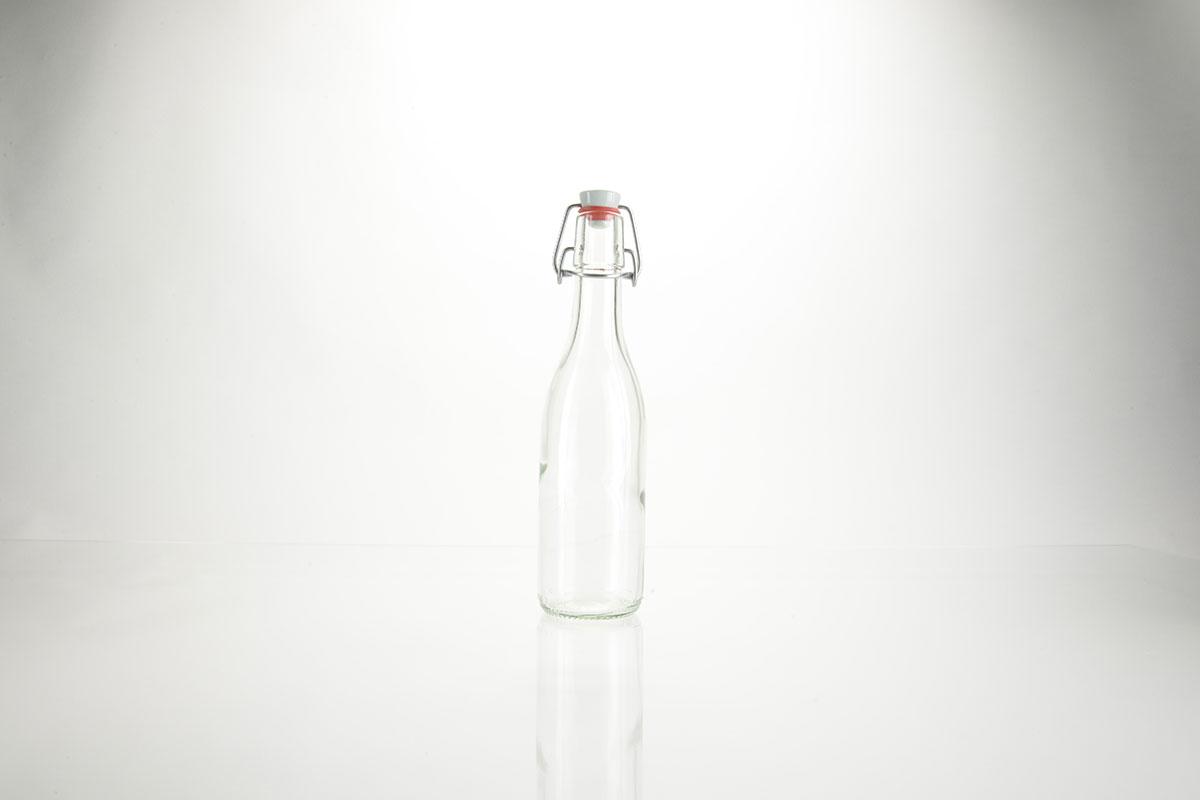 Bouteilles à limonade en verre blanc avec fermeture mécanique et tête en porcelaine