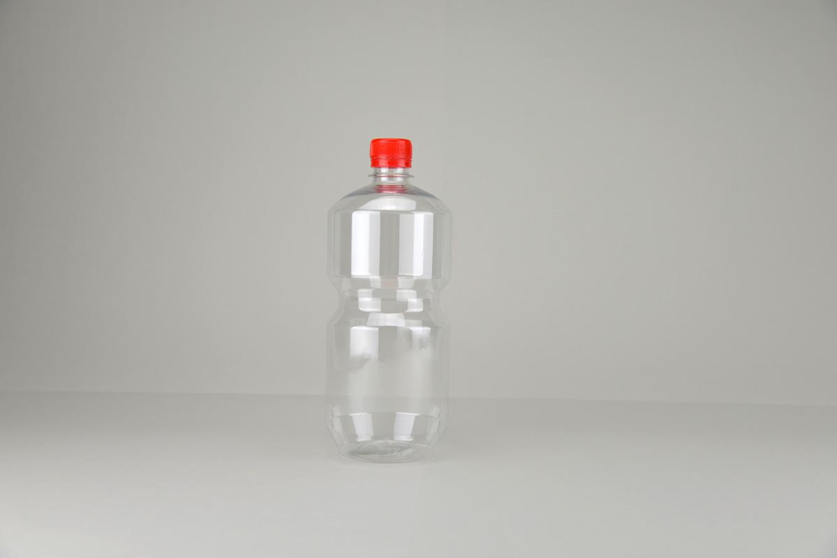 Bouteille en PET transparente 1litre avec bouchon inviolable rouge