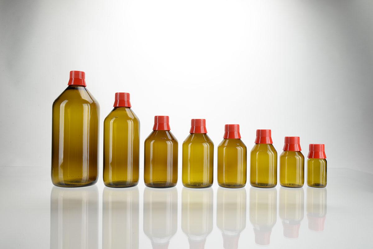Flacons APONORM en verre brun ronds avec goulot verseur et fermeture de dosage rouge